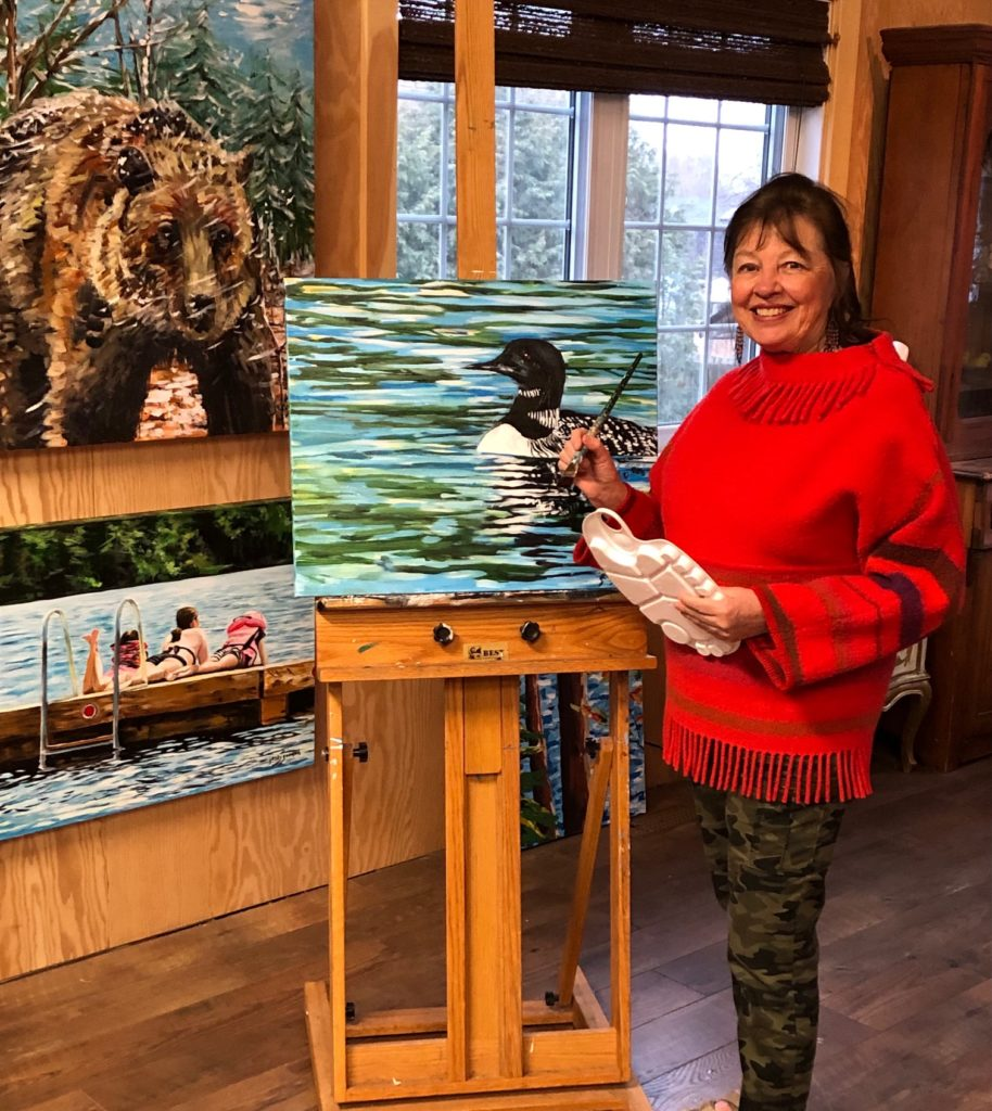 Picture of Jenny Gordon in her studio painting